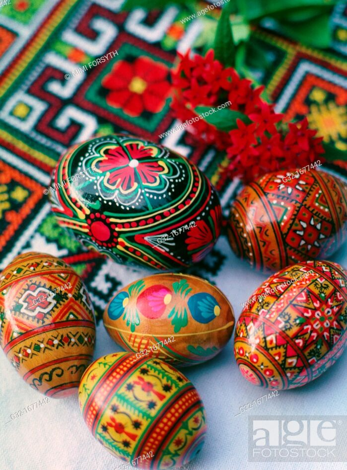 Stock Photo: Ukrainian folk designs on Easter eggs, on cloth with Ukrainian folk embroidered designs.