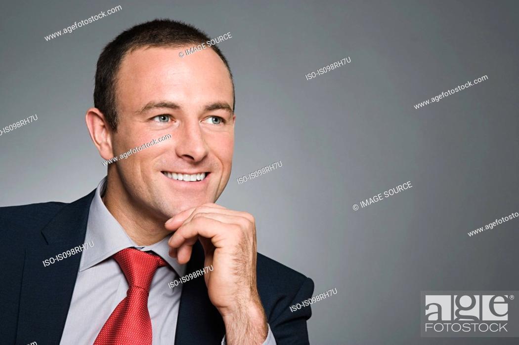 Stock Photo: Portrait of a smiling businessman.