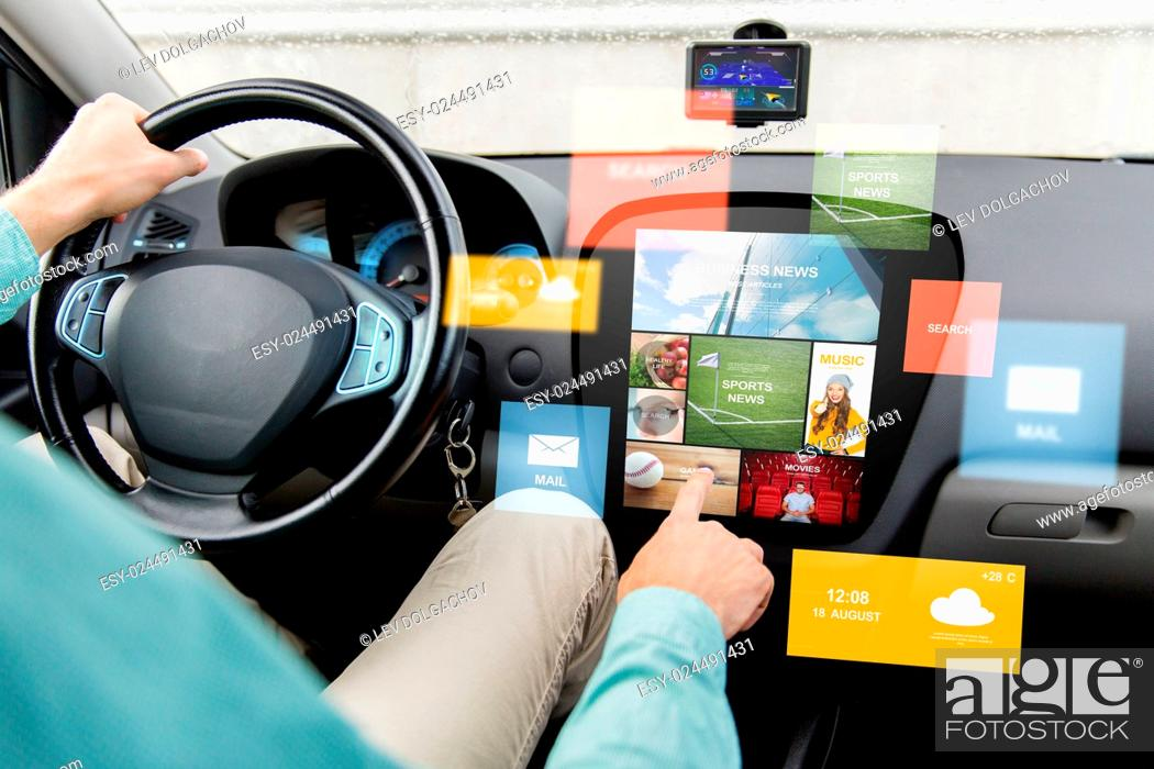 Stock Photo: transport, modern technology, media and people concept - close up of man driving car with news on board computer screen.
