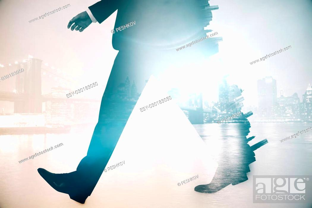 Photo de stock: Legs of walking businessman in suit on abstract city background. Double exposure.