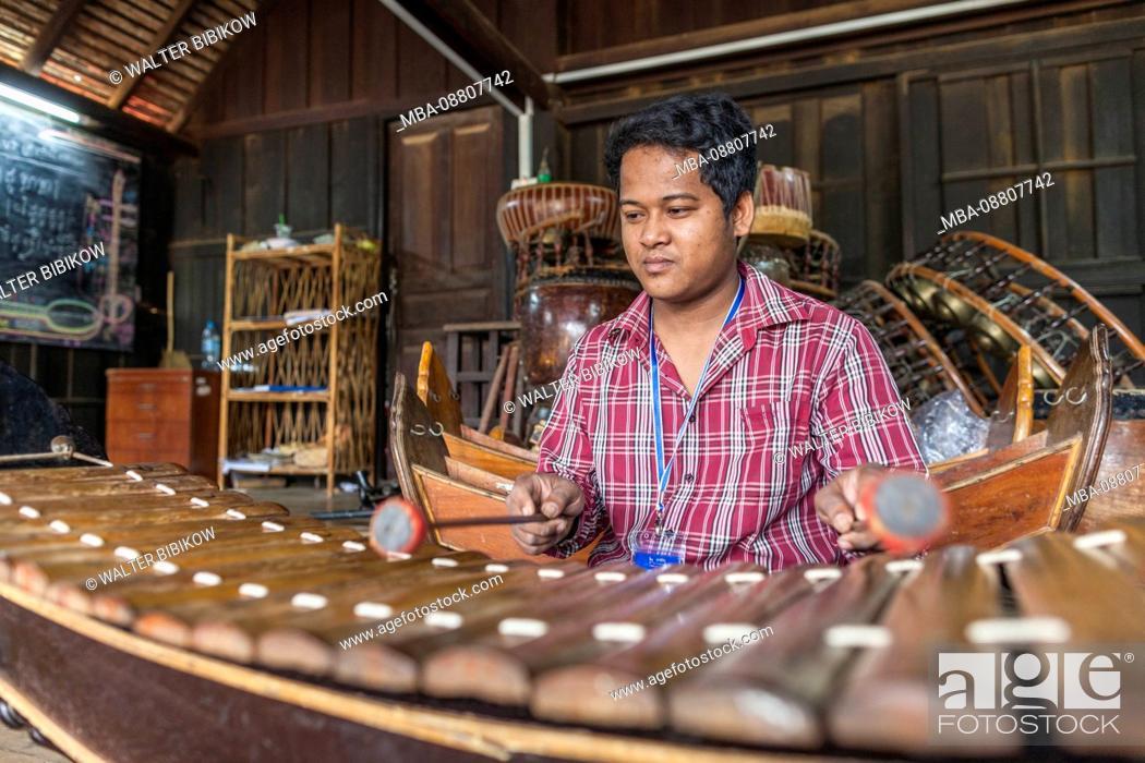 Stock Photo: Cambodia, Battambang, Phar Ponleu Selpak, arts and circus school, musician and roneat, traditional Khmer xylophone, ER.