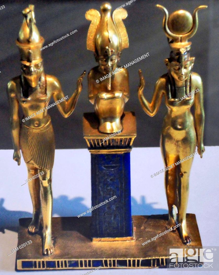 Stock Photo: three gods statuette for King Osorkon II depicts the family of the god Osiris Osiris is flanked by Horus left and Isis right.