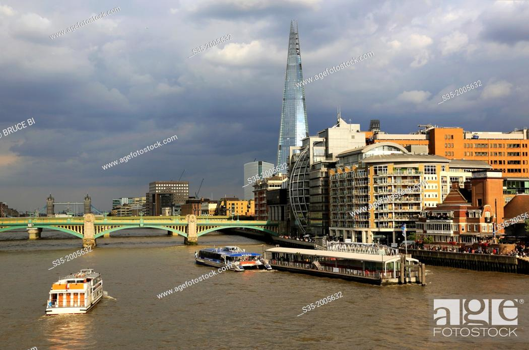 Stock Photo: A tour boat in River Thames with the Shard the tallest building in the European Union in the background, London, England, UK.