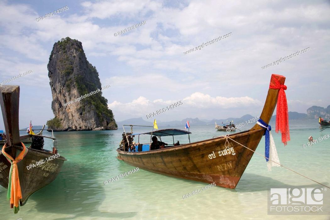 Stock Photo: Boat in the green clean sea water ; Krabi Island ; Thailand.
