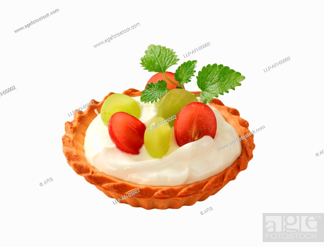Stock Photo: Small cream tart topped with fresh grapes.
