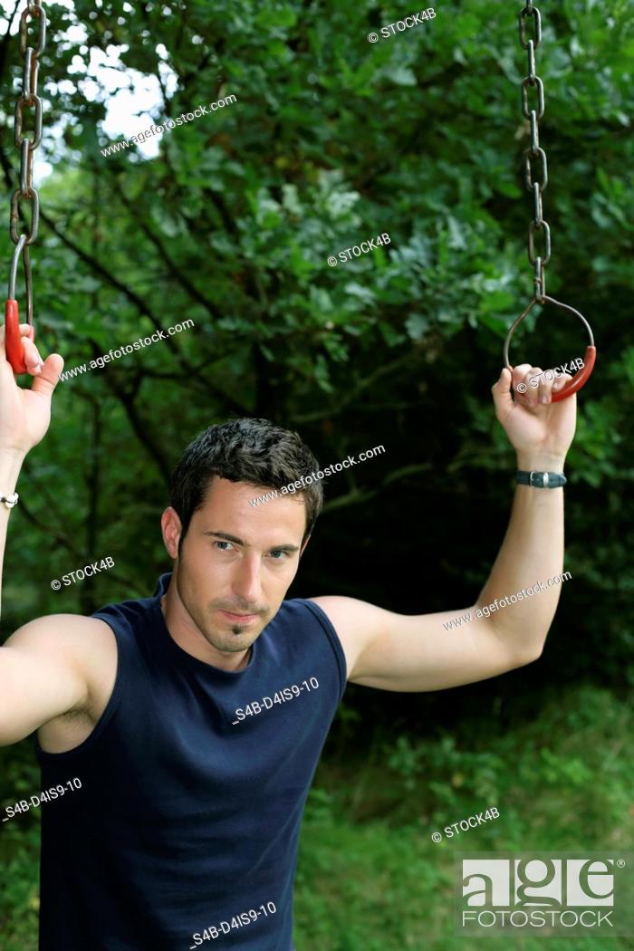 Stock Photo: Man standing between rings.