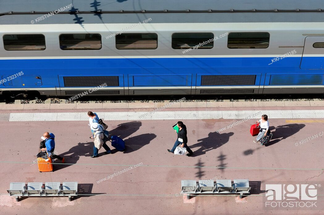 Stock Photo: People with baggage walking along the platform of Nice mainstation, South France, Europe.