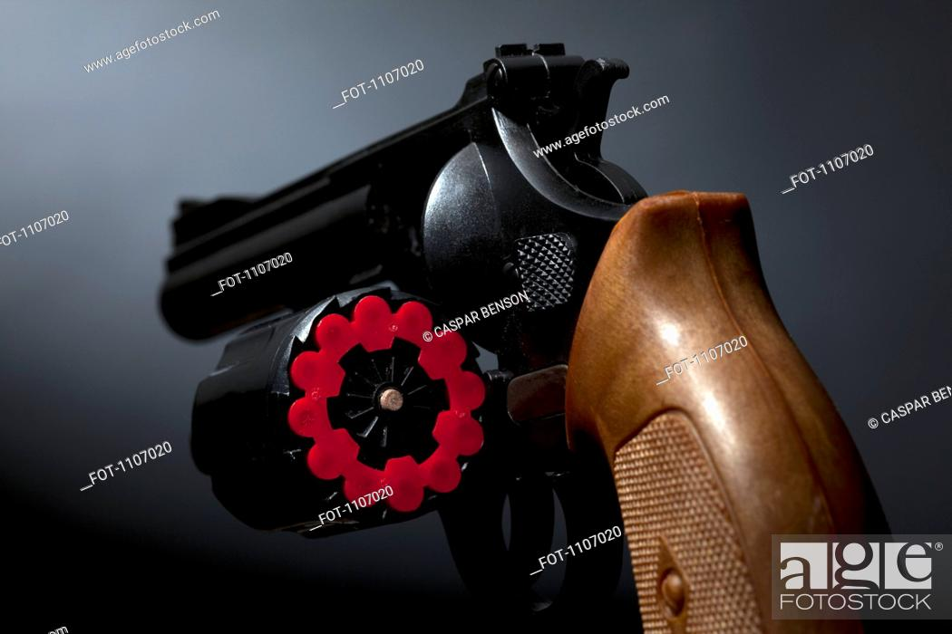 Stock Photo: BBs loaded in the chamber of a BB gun.