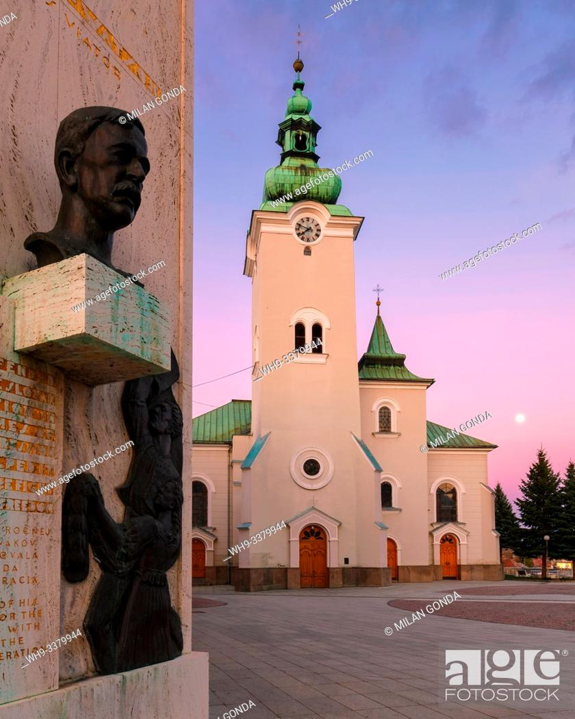 Stock Photo: Memorial and a church in the main square of Ruzomberok. Slovakia.