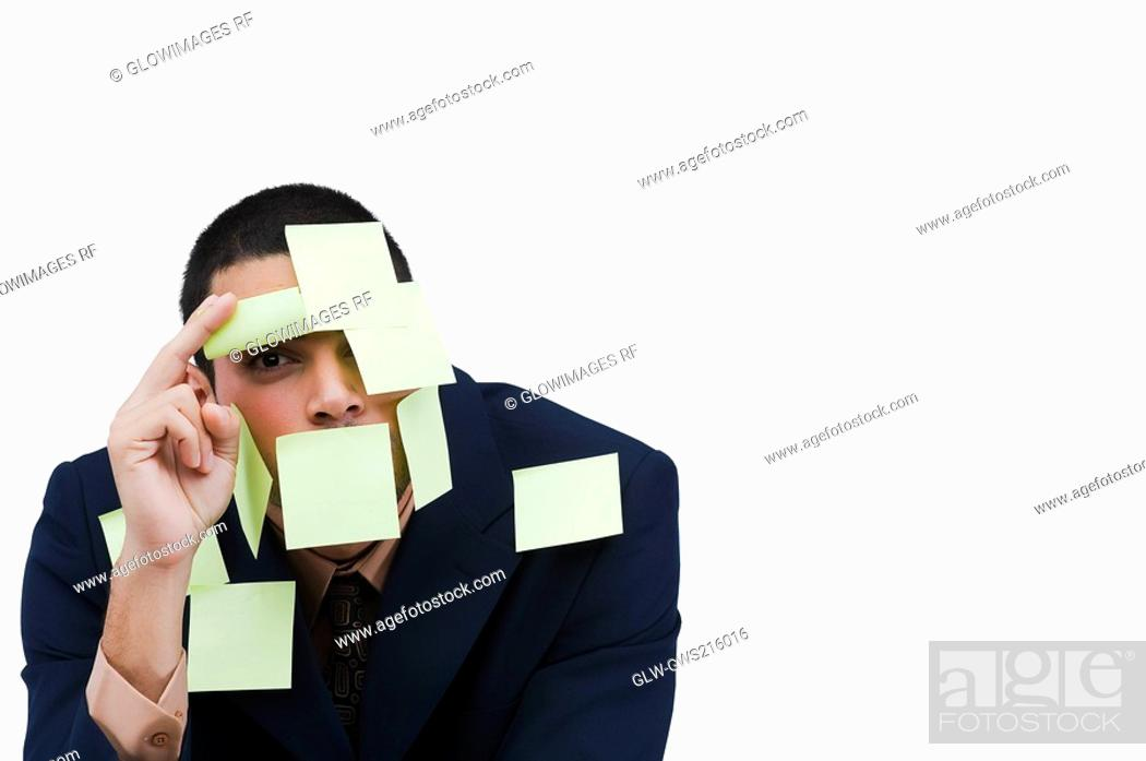 Stock Photo: Portrait of a businessman covered with adhesive notes.