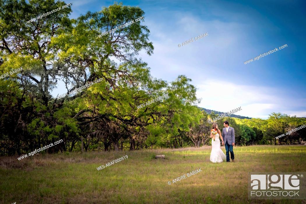Stock Photo: USA, Texas, Bride and groom at wedding ceremony.