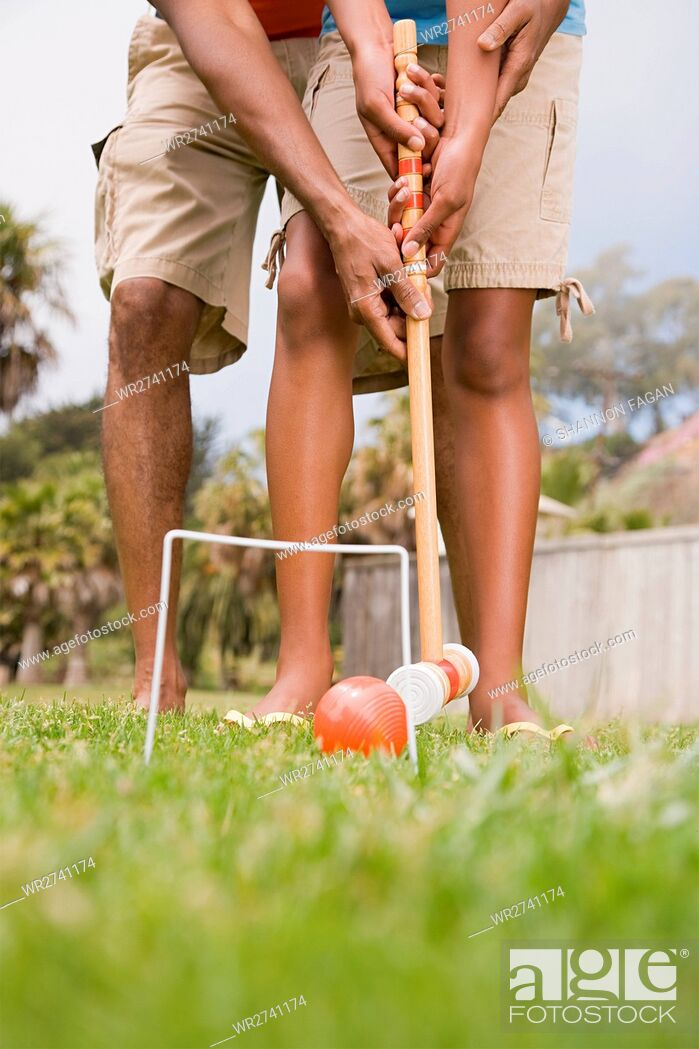 Stock Photo: Two people playing croquet.