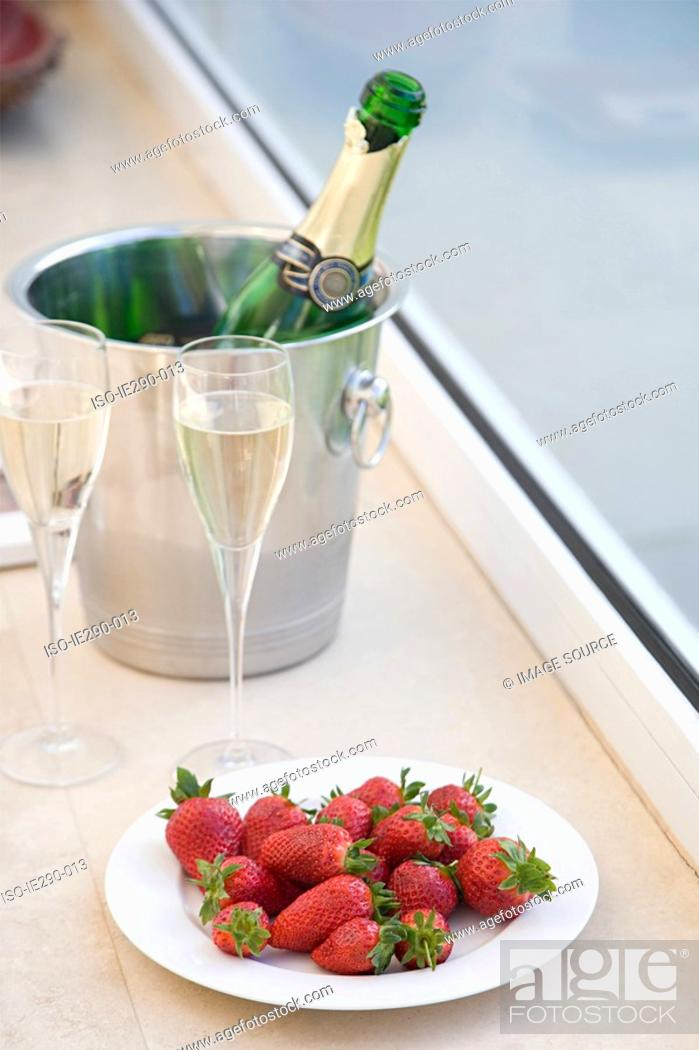 Stock Photo: Strawberries and champagne.