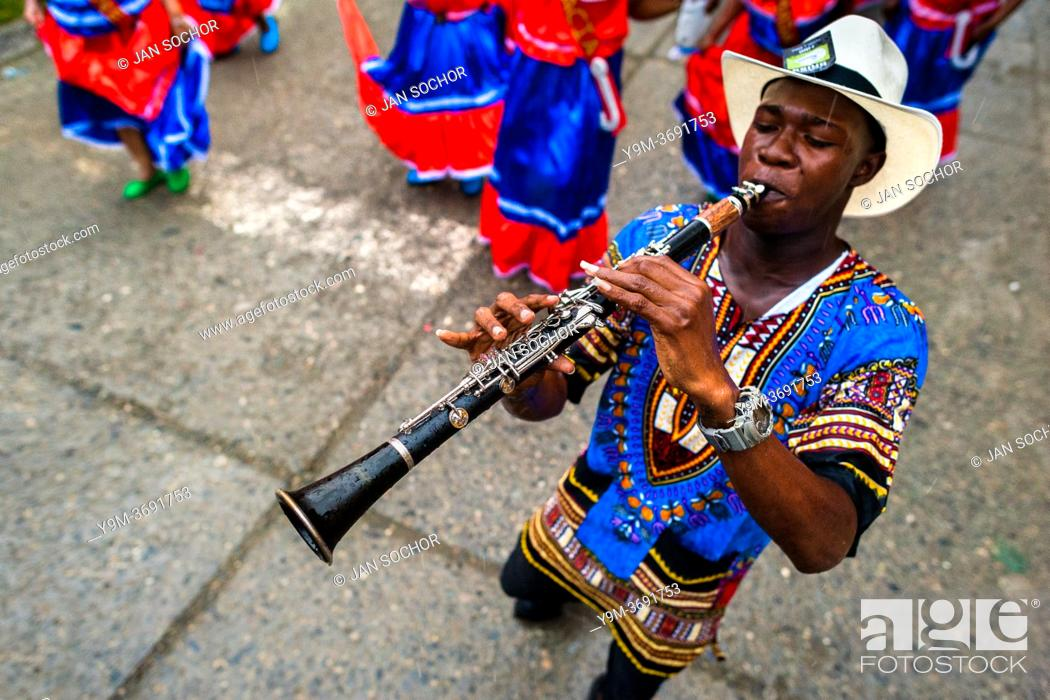 Stock Photo: An Afro-Colombian clarinet player of the Pandeyuca neighborhood performs during the San Pacho festival in Quibdó, Colombia, 29 September 2019.