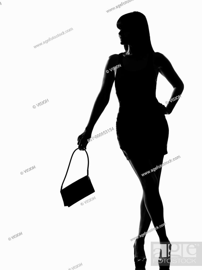 Stock Photo: stylish silhouette caucasian beautiful woman holding purse waiting full length on studio isolated white background.