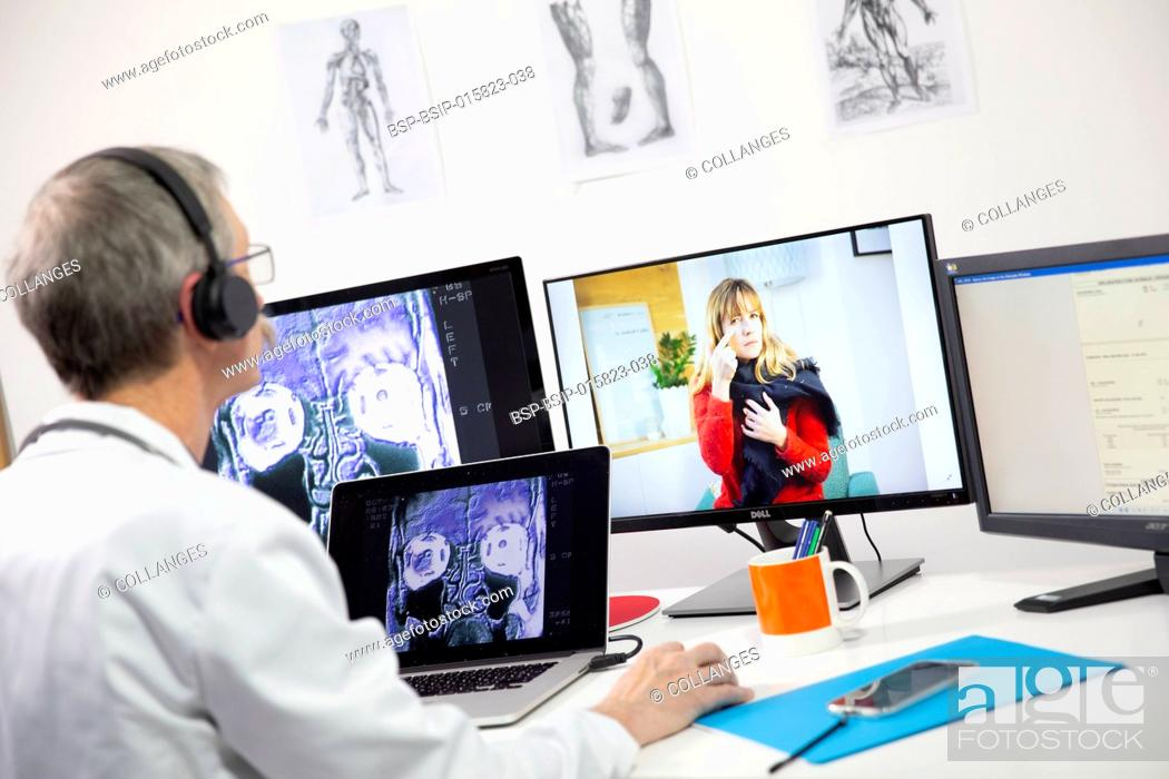 Stock Photo: A GP during a video consultation, looking at the x-ray of a woman's sinuses who has a pain in her sinuses.