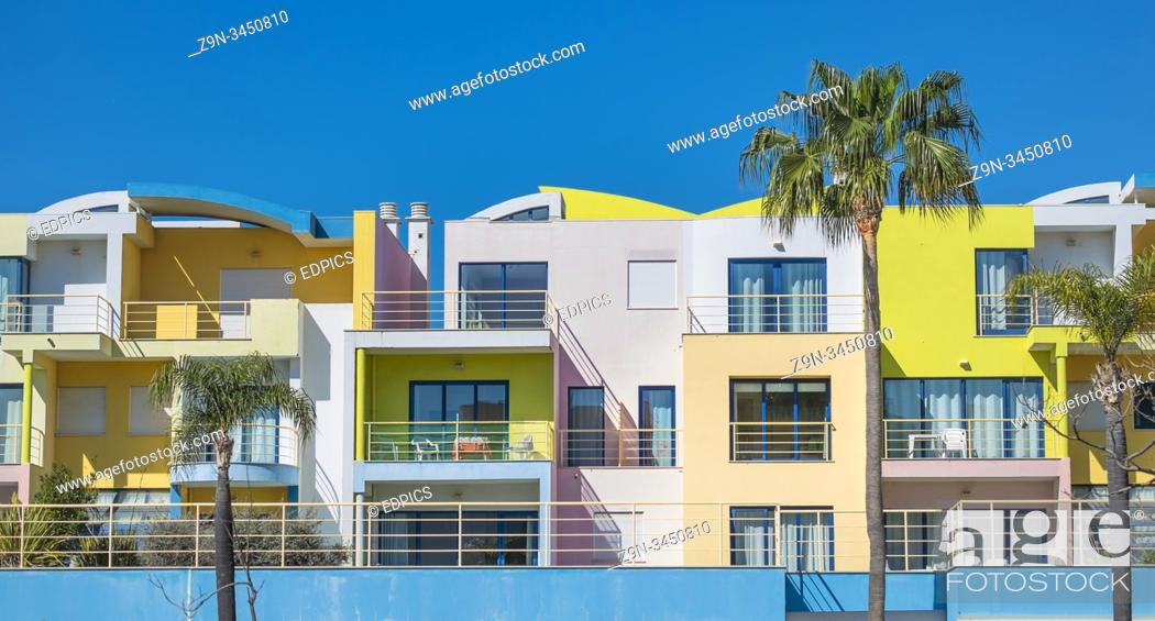 Stock Photo: pastel colored postmodern holiday apartment blocks at albufeira marina, albufeira, algarve, portugal.