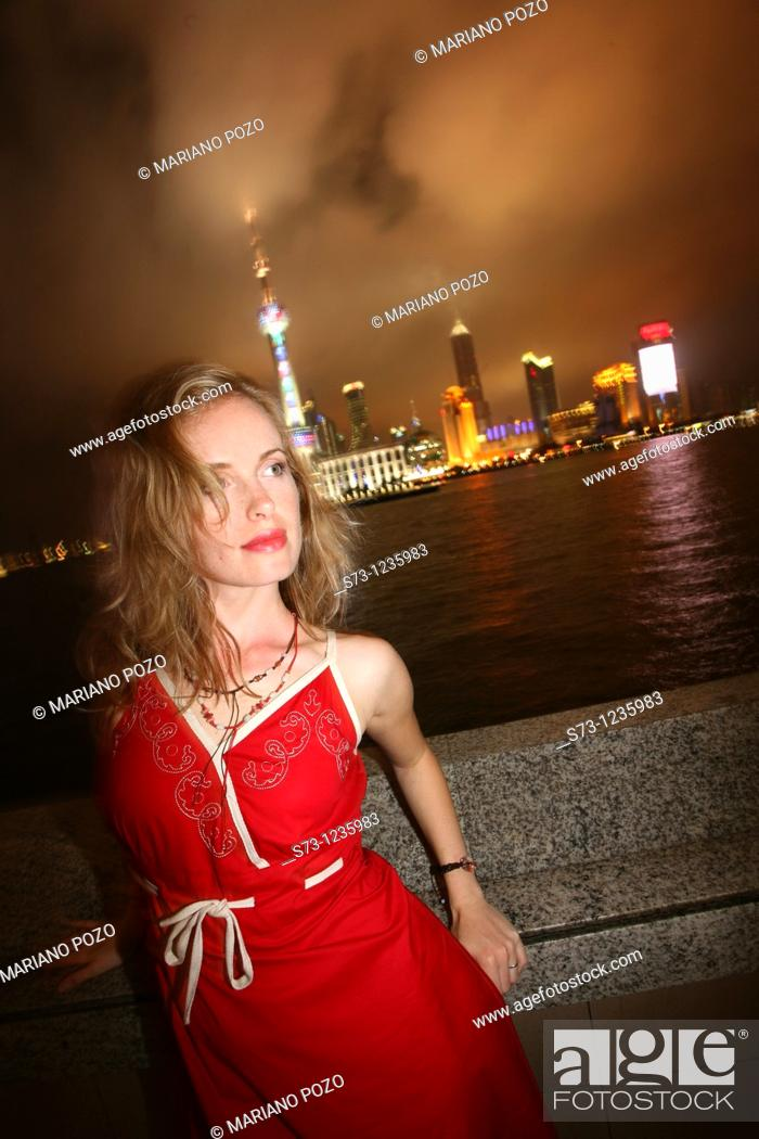 Stock Photo: 27 year old woman poses in Shanghai. China.
