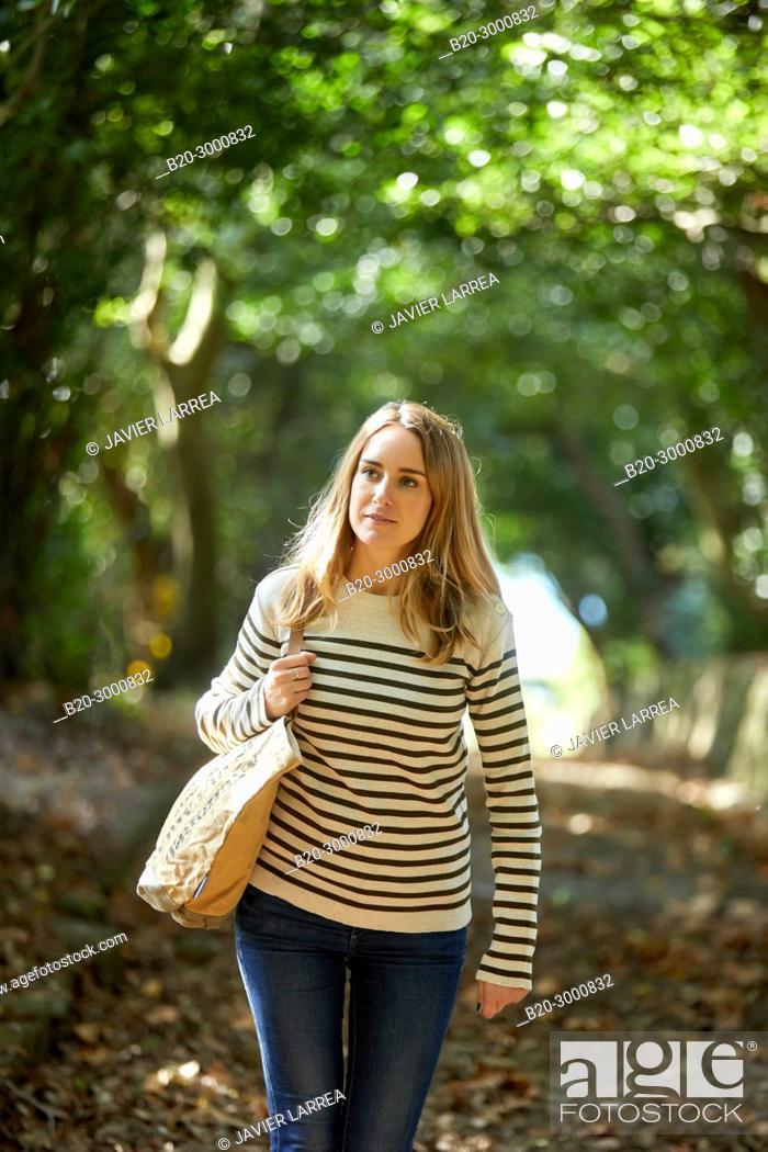 Stock Photo: Adult woman wearing sea clothes, Santa Clara Island, Donostia, San Sebastian, Gipuzkoa, Basque Country, Spain, Europe.