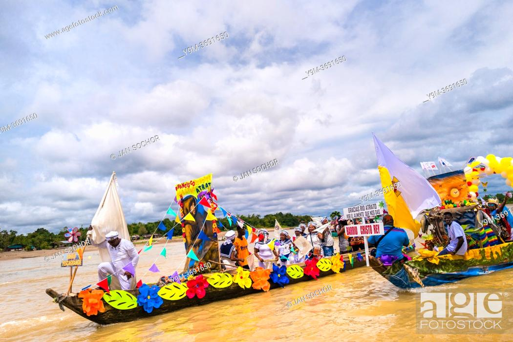 Stock Photo: The Franciscan districts representatives travel the Atrato river in colorfully adorned boats during the San Pacho festival in Quibdó, Colombia, 3 October 2019.