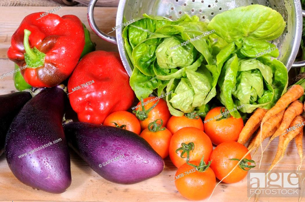 Stock Photo: Freshly harvested home grown organic salad vegetables, washed in colander and ready for the kitchen, UK.