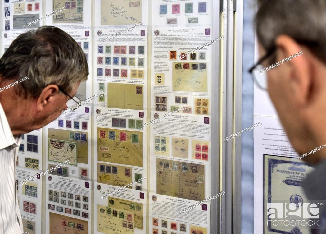 People look at post office stamps during the Praga 2018