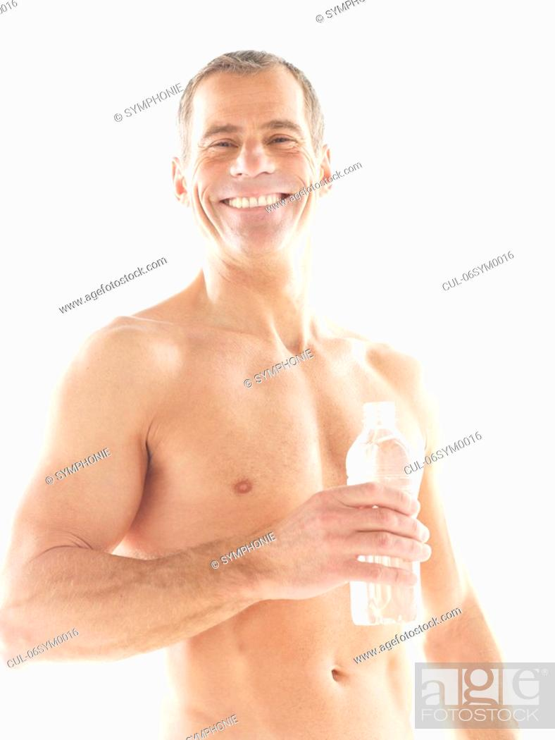 Stock Photo: Mature man with glass of water.