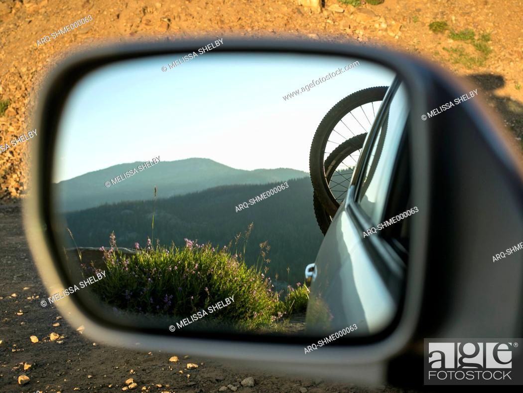 Imagen: Photograph with mountain bicycles on rack on back of car reflecting in side view mirror, McCall, Idaho, USA.