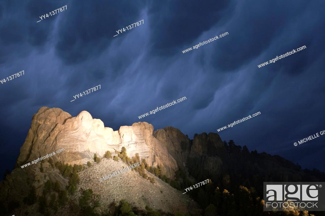 Stock Photo: Storm clouds over Mount Rushmore National Memorial, at night, South Dakota, USA.