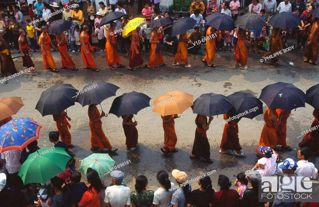 Stock Photo: Buddhist monks procession during the new year festival (Pi Maï), Luang Phra Bang, Laos.