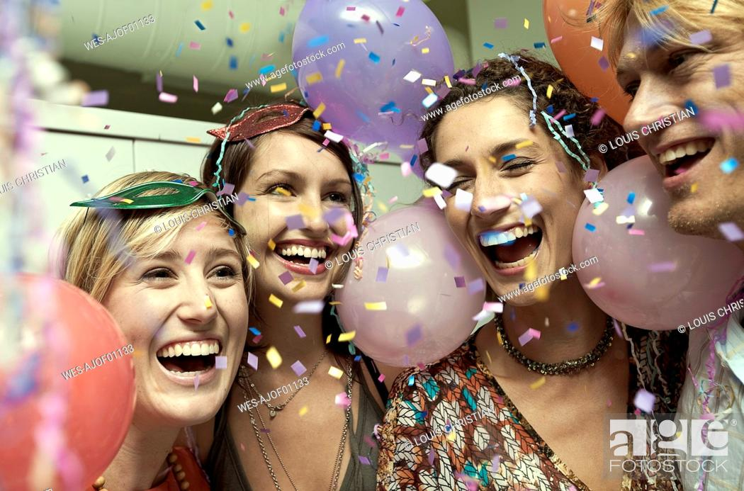 Stock Photo: Cheerful friends smiling while enjoying party together.