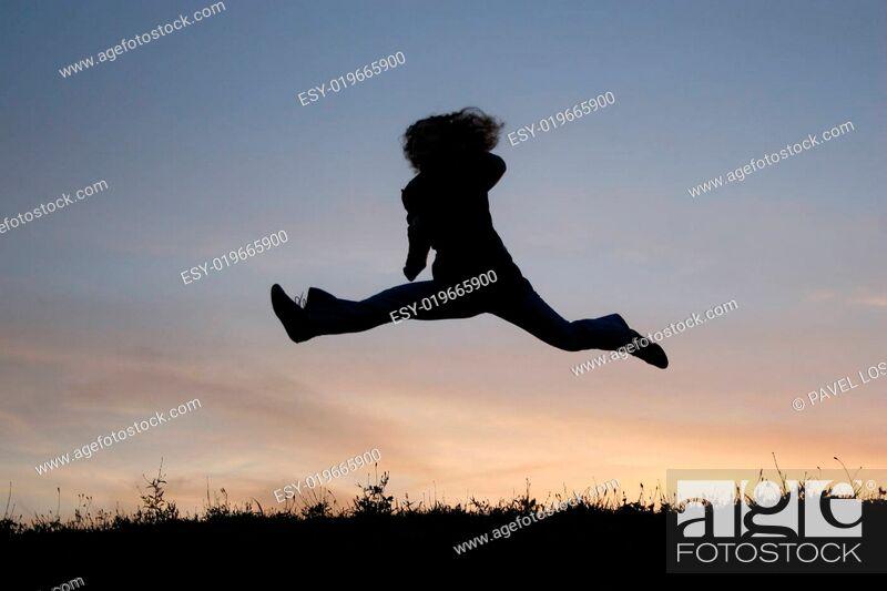 Stock Photo: silhouette jump girl.