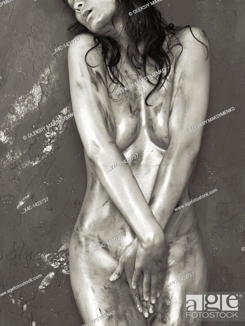 Stock Photo: Beautiful naked woman with shiny soiled body.
