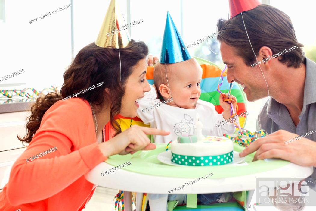 Stock Photo: Parents and baby celebrating first birthday.