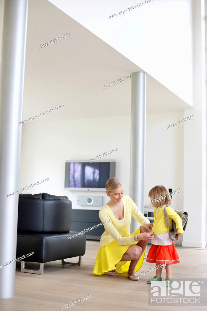 Stock Photo: Woman helping her daughter to get ready.