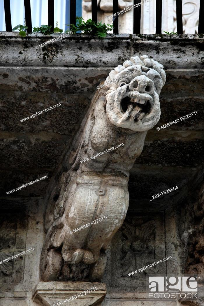 Stock Photo: Detail of a baroque corbel supporting a balcony, Acireale Sicily, Italy.