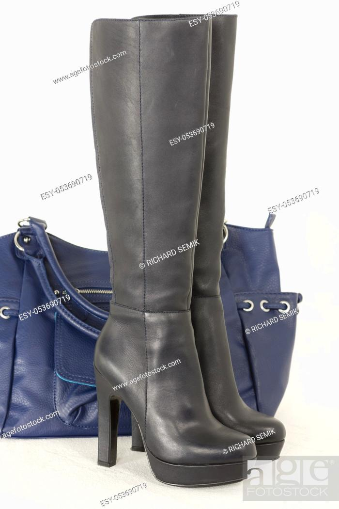 Stock Photo: fashionable black boots with a handbag.