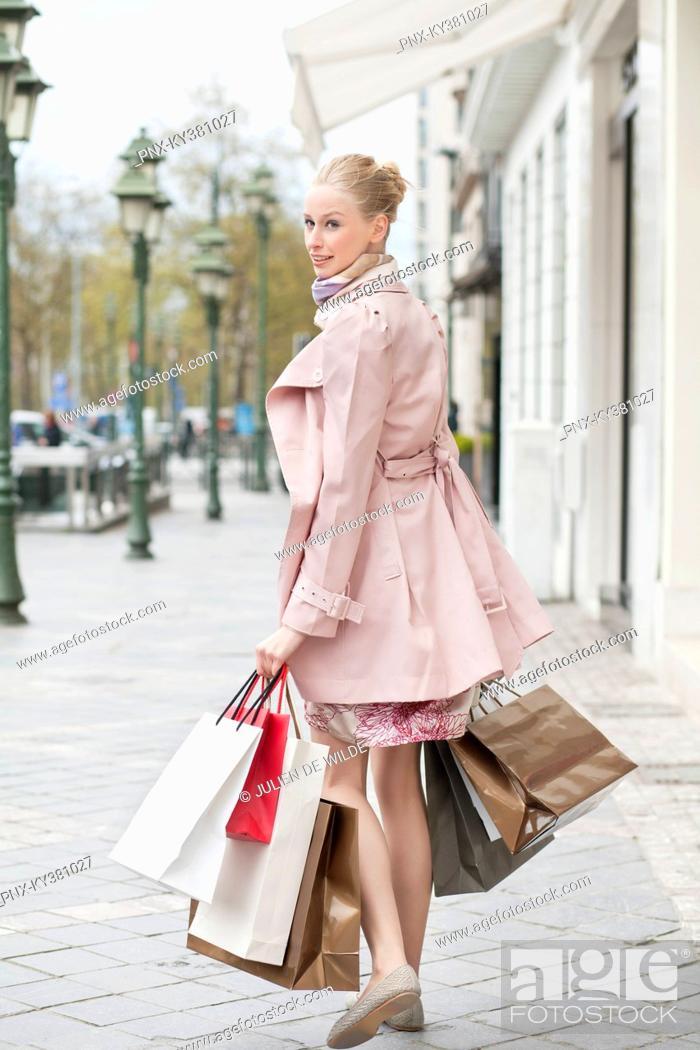 Stock Photo: Woman carrying shopping bags.
