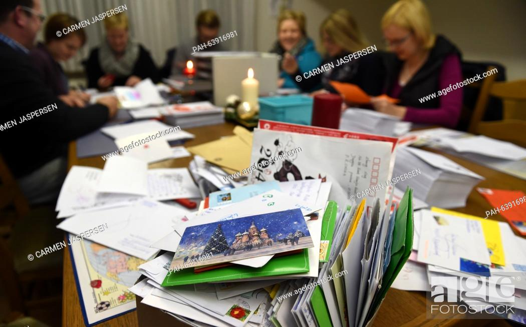 Stock Photo: Employees of 'Santa Claus' respond to letters in the Santa Claus office in Nikolausdorf (lit. Nicholas village), Germany, 24 November 2015.