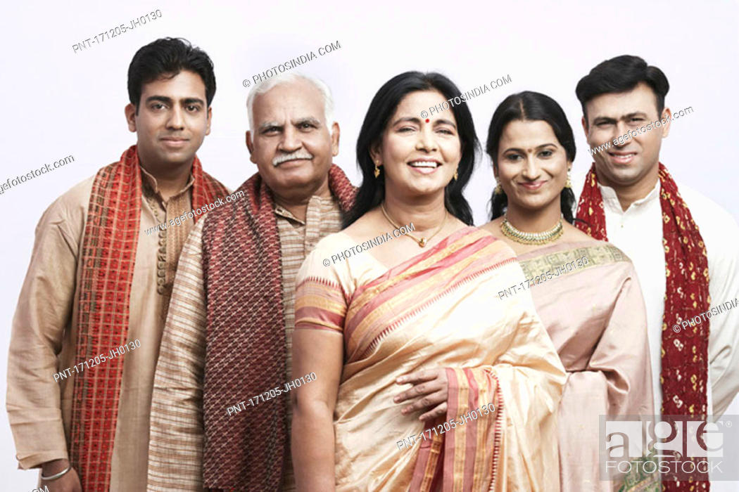 Stock Photo: Portrait of a mature couple and their children smiling.