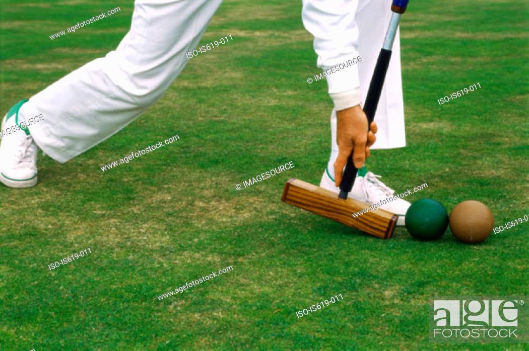 Stock Photo: Man playing croquet.