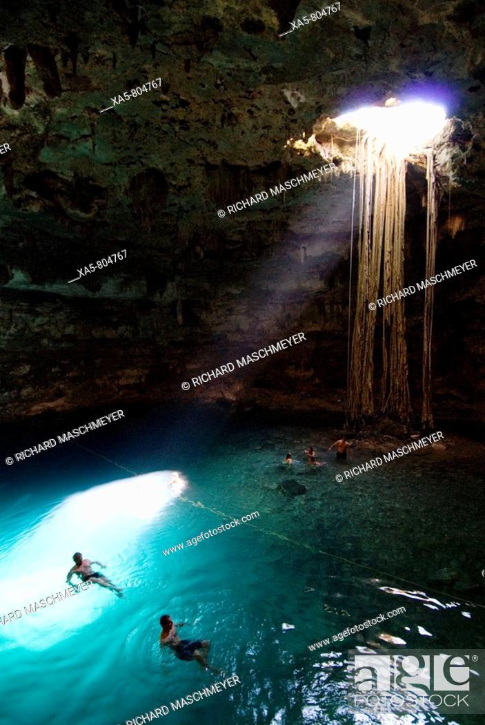 Stock Photo: Mexico, Yucatan, Cenote Samula, near Valladolid, tourists enjoying a swim.