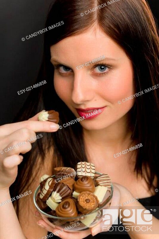 Stock Photo: Chocolate - portrait young woman enjoy candy.