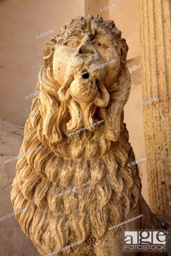 Stock Photo: Detail of a lion statue outside Madona del Carmine church. Nardo. Italy.