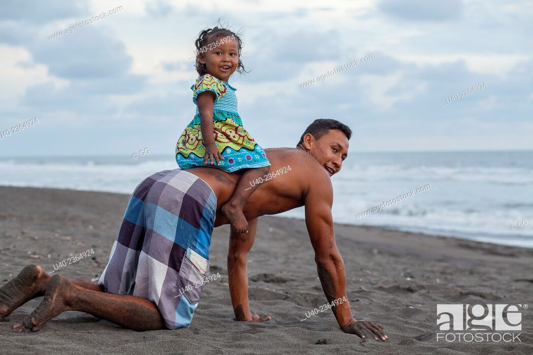 Stock Photo: Guatemala, Father and daughter playing on the beach.