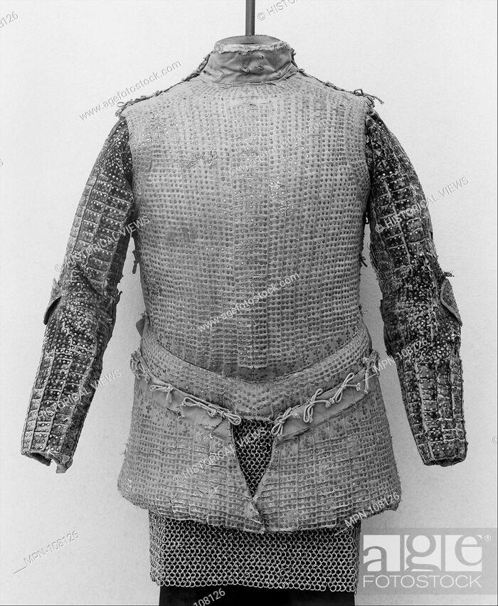 Imagen: Brigandine. Date: ca. 1540-50; Culture: Italian; Medium: Textile, tinned iron, gilt brass; Classification: Brigandines; Credit Line: Gift of William H.