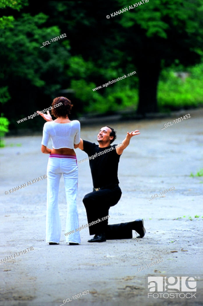 Stock Photo: Passionate lovers in a park.