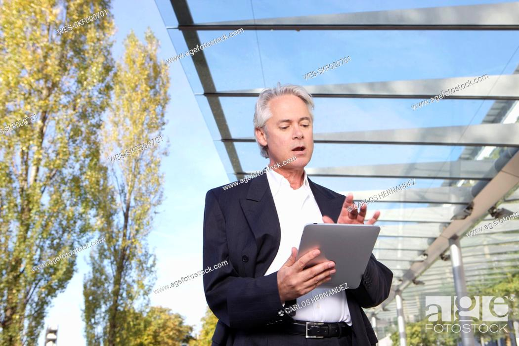 Stock Photo: Germany, Bavaria, Munich, Businessman with digital tablet.