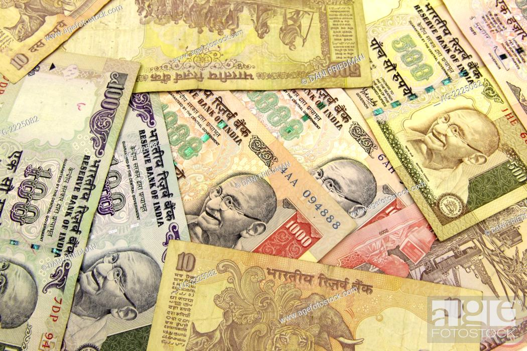 Stock Photo: An assortment of Indian rupee notes. - NEW DELHI, DELHI, INDIA, 21/05/2010.