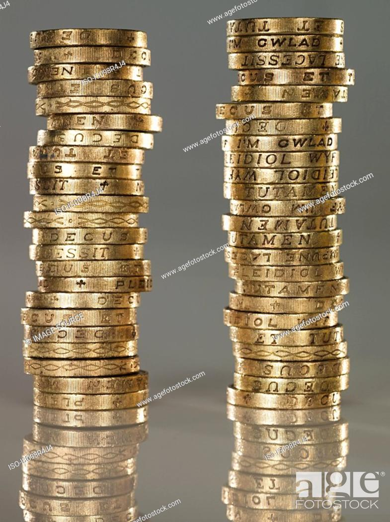 Stock Photo: Stacks of one pound coins.